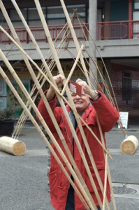Visitors tie their Olympic wishes on the bamboo/cedar gates in Chinatown.